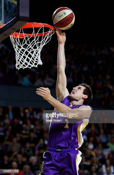 Ben Madgen of the Kings drives to the basket during the round one NBL match between the Sydney Kings and the New Zealand Breakers at Sydney...