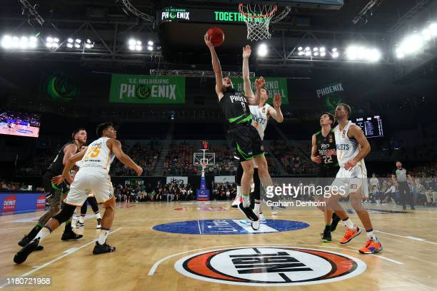 Ben Madgen of the Phoenix drives at the basket during the round two NBL match between the South East Melbourne Phoenix and the Brisbane Bullets at...
