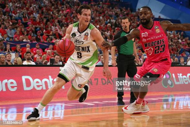 Ben Madgen of the Phoenix drives to the basket against Terrico White of the Wildcats during the round four NBL match between the Perth Wildcats and...