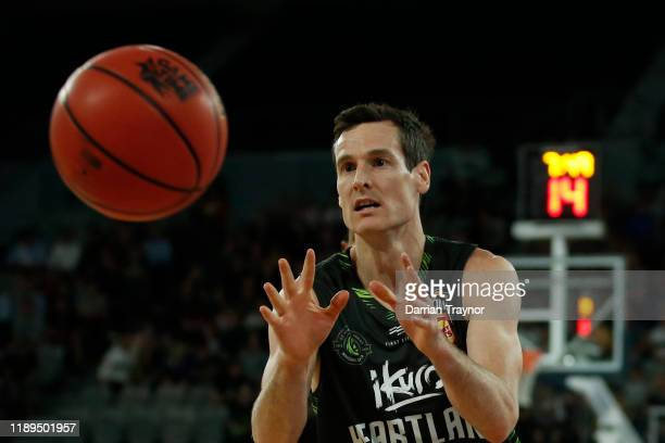 Ben Madgen of the Phoenix gathers the ball during the round 8 NBL match between the South East Melbourne Phoenix and the Sydney Kings at Melbourne...
