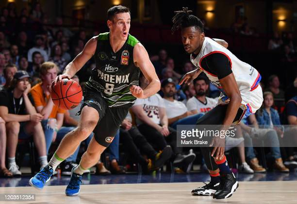Ben Madgen of the Phoenix gets around Eric Griffin of the 36ers during the round 18 NBL between Adelaide 36ers and the South East Melbourne Phoenix...