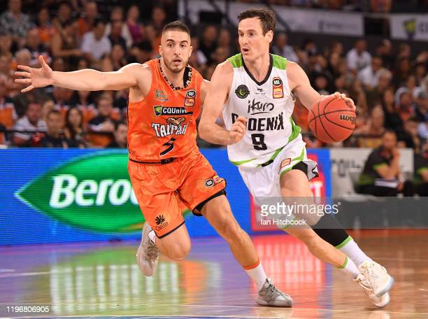 Ben Madgen of the Phoenix gets past Mirko Djeric of the Taipans during the round 13 NBL match between the Cairns Taipans and the South East Melbourne...