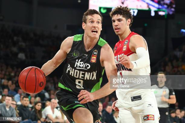 Ben Madgen of the Phoenix handles the ball under pressure from LaMelo Ball of the Hawks during the round three NBL match between the South East...