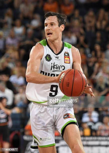 Ben Madgen of the Phoenix looks to pass the ball during the round 13 NBL match between the Cairns Taipans and the South East Melbourne Phoenix on...
