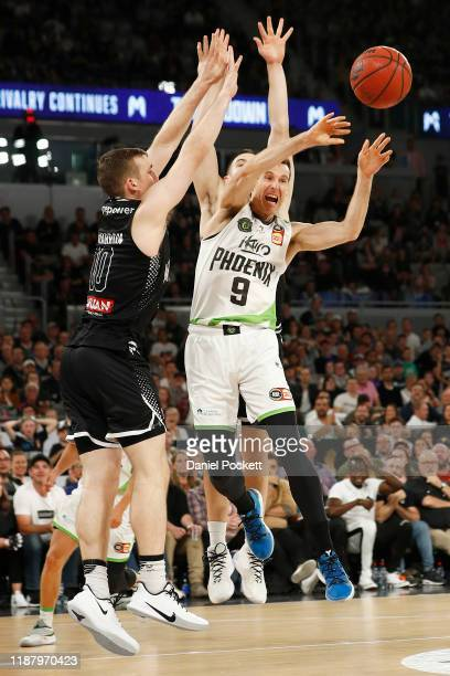 Ben Madgen of the Phoenix passes the ball during the round seven NBL match between Melbourne United and the South East Melbourne Phoenix at Melbourne...