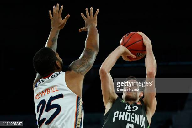 Ben Madgen of the Phoenix shoots the ball during the round 11 NBL match between the South East Melbourne Phoenix and the Cairns Taipans at Melbourne...
