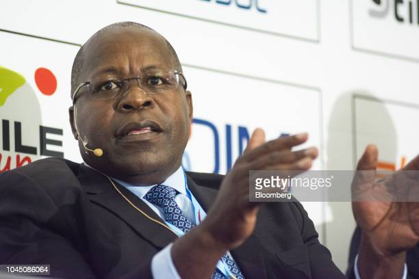 Ben Magara, chief executive officer of Lonmin Plc, gestures as he speaks on the opening day of the Investing In 'Resources And Mining In Africa'...