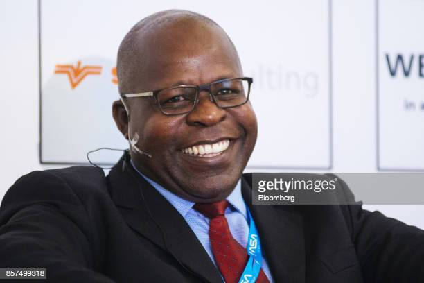 Ben Magara, chief executive officer of Lonmin Plc, reacts during a panel discussion on the opening day of the Investing in African Mining Indaba in...