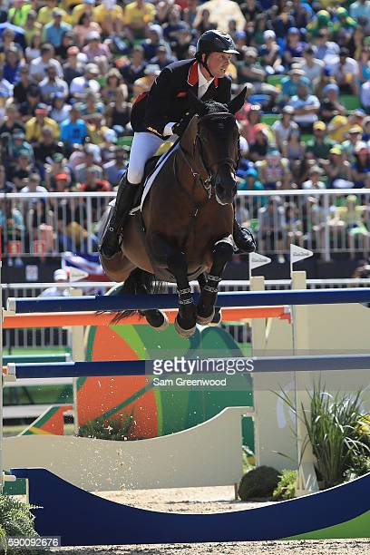 Ben Maher of Great Britain rides Tic Tac during the Team Jumping on Day 11 of the Rio 2016 Olympic Games at the Olympic Equestrian Centre on August...