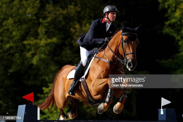 Ben Maher of Great Britain riding Explosion W competes during Day 3 of the Longines FEI Jumping European Championship, speed competition against the...