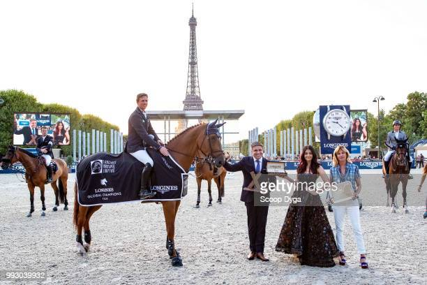 Ben Maher riding Explosion W Virginie Couperie Eiffel Aishwarya Rai and Juan Carlos Capelli the Longines Eiffel Challenge at Champ de Mars on July 6...