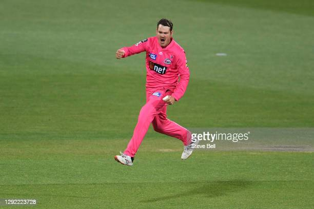 Ben Manenti of the Sixers celebrates the wicket of Matt Renshaw of the Strikers during the Big Bash League match between the Sydney Sixers and the...