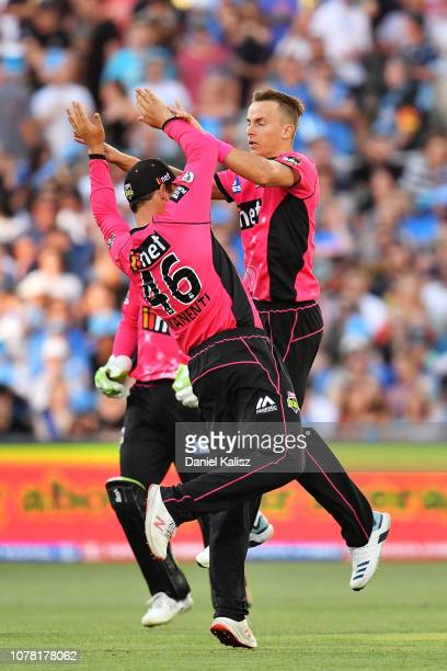 Ben Manenti of the Sixers celebrates with Tom Curran of the Sixers during the Big Bash League match between the Adelaide Strikers and the Sydney...