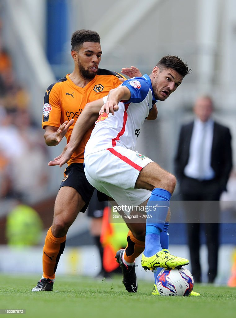 Ben Marshall of Blackburn Rovers and Scott Golbourne of Wolverhampton Wanderers during the Sky Bet Championship match between Blackburn Rovers and Wolverhampton Wandereres at Ewood park on August 8, 2015 in Blackburn, England.