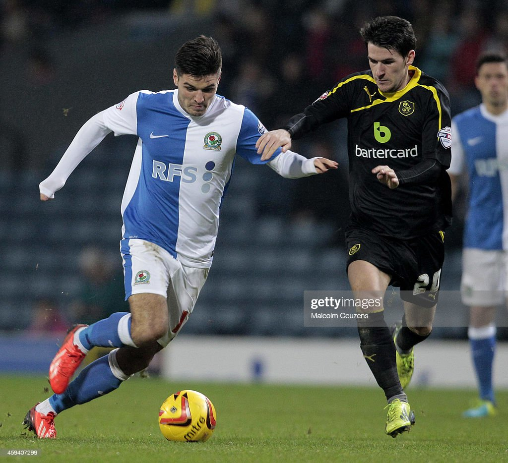 Ben Marshall (L) of Blackburn Rovers competes with Kieran Lee of Sheffield Wednesday (right) during the Sky Bet Championship match between Blackburn Rovers and Sheffield Wednesday at Ewood Park on December 26, 2013 in Blackburn, England.