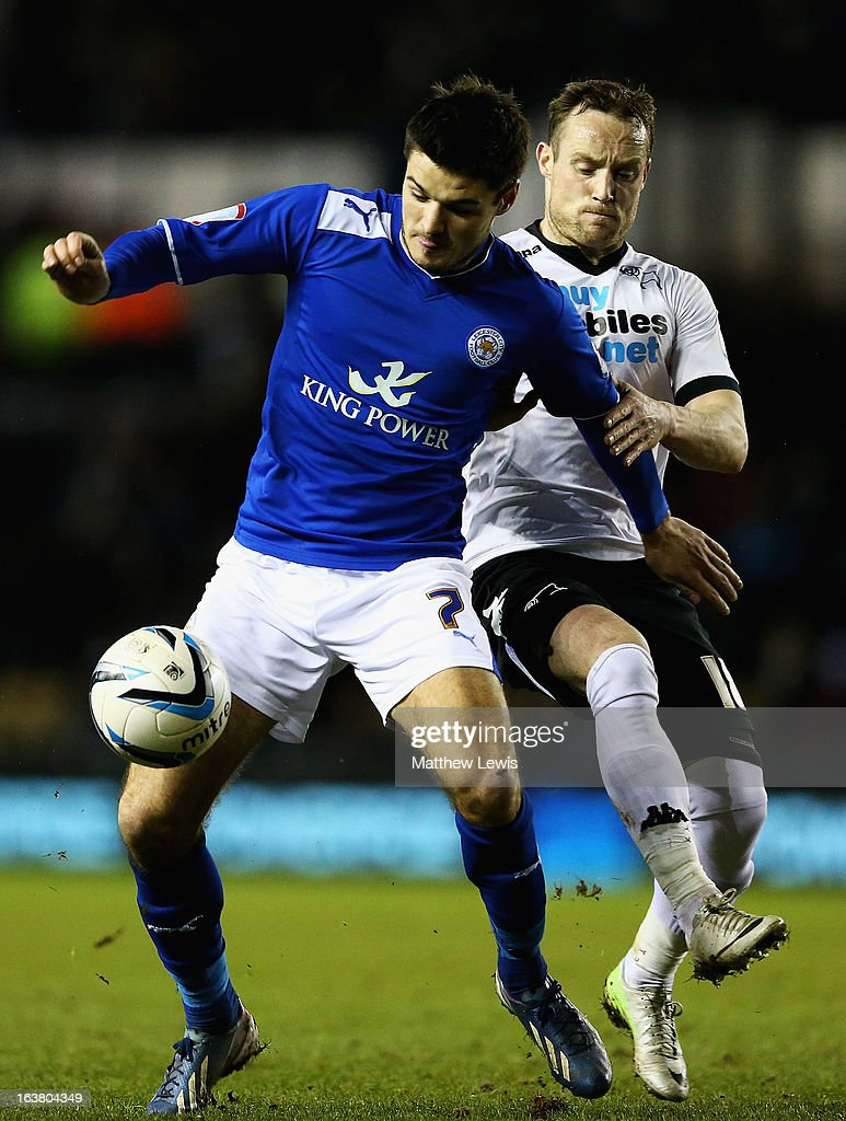 Ben Marshall of Leicester and Ben Davies of Derby challenge for the ball during the npower Championship match between Derby County and Leicester City at Pride Park Stadium on March 16, 2013 in Derby, England.