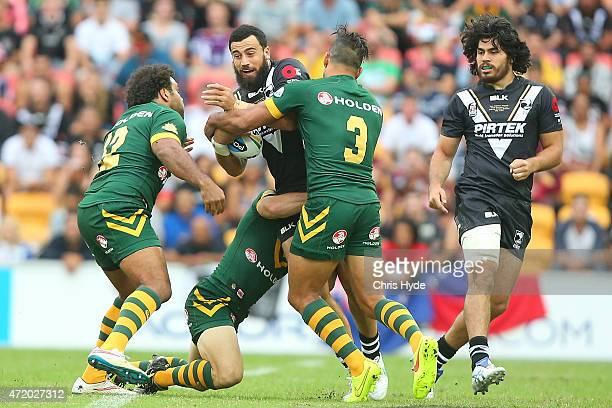 Ben Matulino of New Zealand is tackled during the TransTasman Test match between the Australia Kangaroos and the New Zealand Kiwis at Suncorp Stadium...