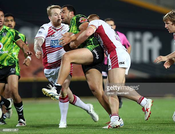 Ben Matulino of the NZ Warriors is tackled by Jack Hughes of Wigan the NZ Warriors and Wigan rugby league match at Waikato Stadium on February 12...