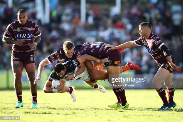 Ben Matulino of the Tigers is tackled by the Sea Eagles defence during the round six NRL match between the Manly Sea Eagles and the Wests Tigers at...