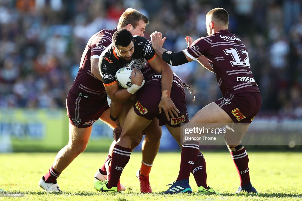 Ben Matulino of the Tigers is tackled by the Sea Eagles defence during the round six NRL match between the Manly Sea Eagles and the Wests Tigers at Lottoland on April 15, 2018 in Sydney, Australia.