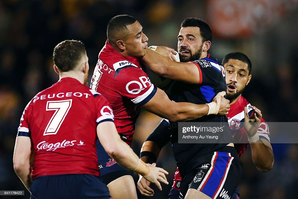 Ben Matulino of the Warriors fends against Sio Siua Taukeiaho of the Roosters during the round 15 NRL match between the New Zealand Warriors and the Sydney Roosters at Mt Smart Stadium on June 19, 2016 in Auckland, New Zealand.