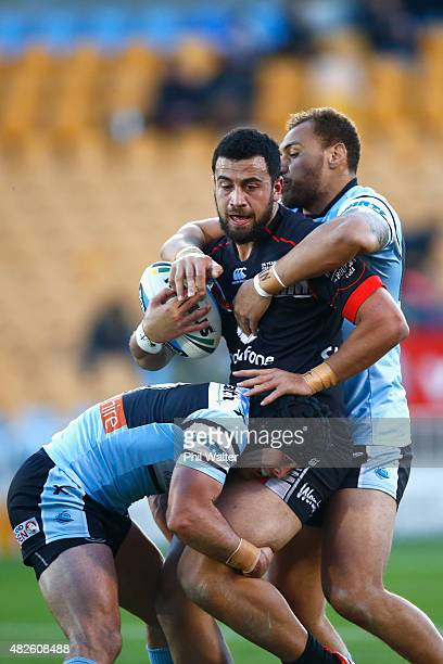 Ben Matulino of the Warriors is tackled during the round 21 NRL match between the New Zealand Warriors and the Cronulla Sharks at Mt Smart Stadium on...
