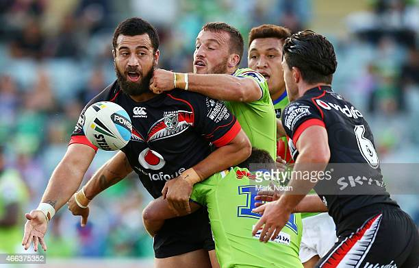 Ben Matulino of the Warriors offloads during the round two NRL match between the Canberra Raiders and the New Zealand Warriors at GIO Stadium on...