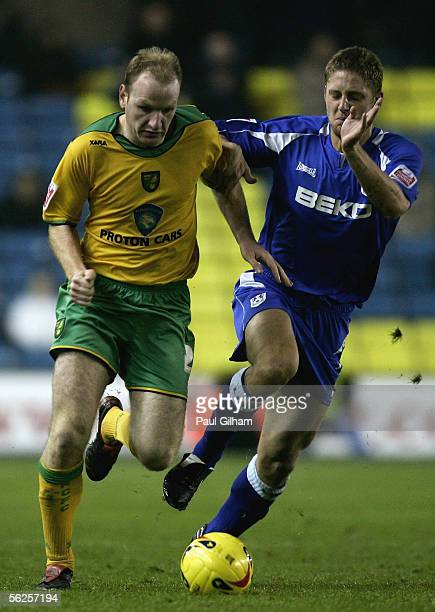 Ben May of Millwall battles for the ball with Gary Doherty of Norwich City during the CocaCola Championship match between Millwall and Norwich City...