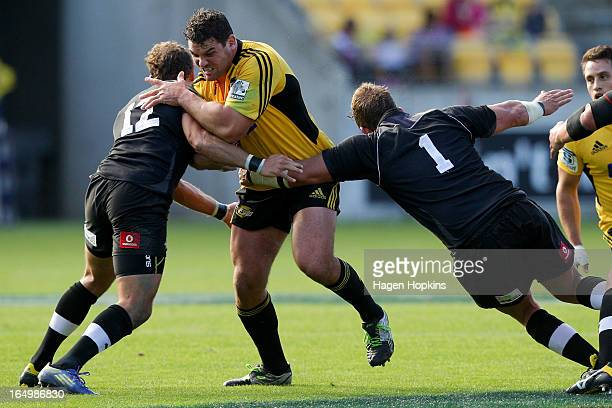 Ben May of the Hurricanes is tackled by Andries Strauss and Schalk Ferreira of the Kings during the round seven Super Rugby match between the...