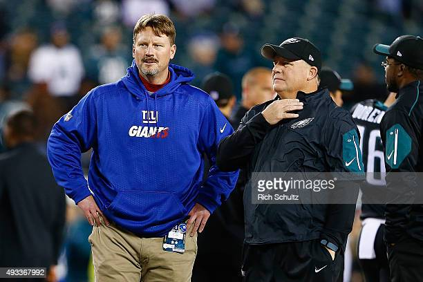 Ben McAdoo offensive coordinator of the New York Giants speaks with head coach Chip Kelly of the Philadelphia Eagles prior to their game at Lincoln...