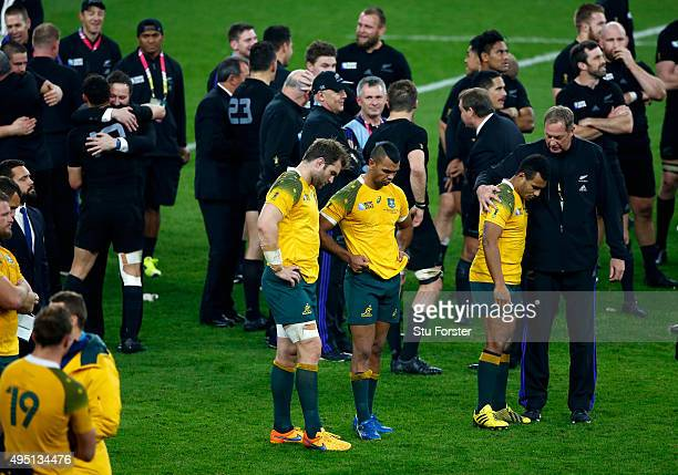 Ben McCalman of Australia Kurtley Beale of Australia and Will Genia of Australia are dejected following defeat in the 2015 Rugby World Cup Final...