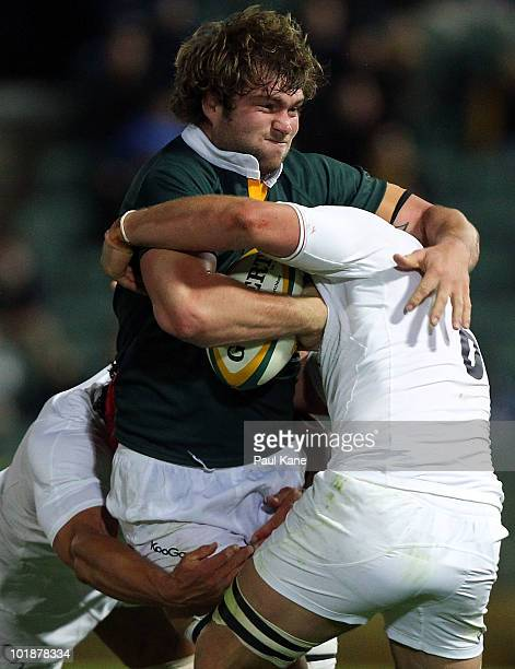 Ben McCalman of the Barbarians gets tackled by Dan WardSmith and Chris Robshaw of England during the match between the Australian Barbarians and...
