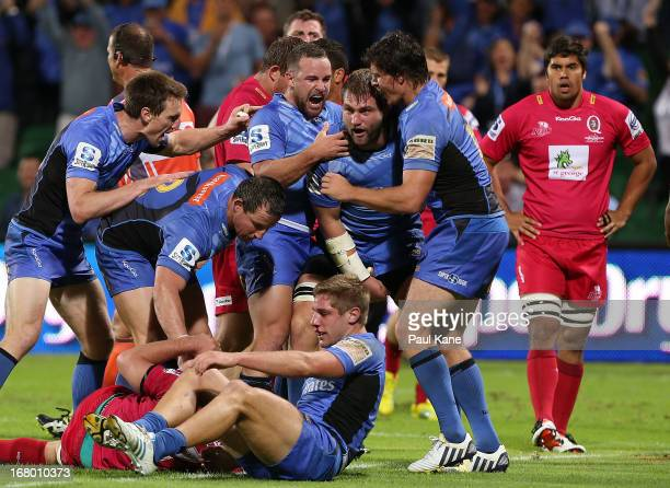 Ben McCalman of the Force is congratulated by Alby Mathewson and Ben Jacobs after scoring a try during the round 12 Super Rugby match between the...