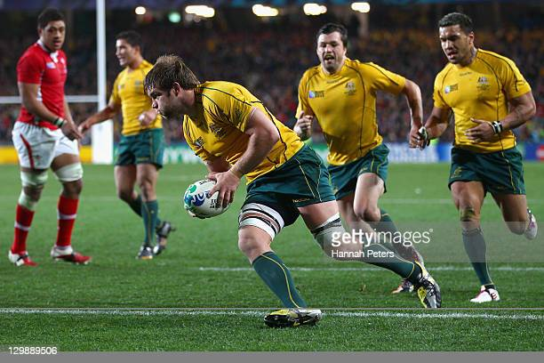 Ben McCalman of the Wallabies goes over to score their second try during the 2011 IRB Rugby World Cup bronze final match between Wales and Australia...