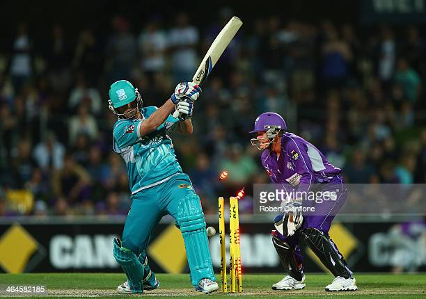 Ben McDermott of the Heat is bowled by Cameron Boyce of the Hurricanes during the Big Bash League match between the Hobart Hurricanes and Brisbane...