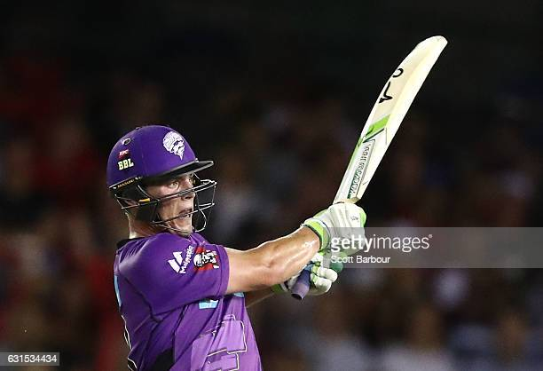 Ben McDermott of the Hurricanes hits a six to bring up his century as he bats during the Big Bash League match between the Melbourne Renegades and...