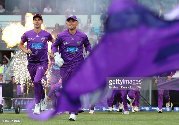 Ben McDermott of the Hurricanes leads out his team prior to the Big Bash League match between the Hobart Hurricanes and the Brisbane Heat at...