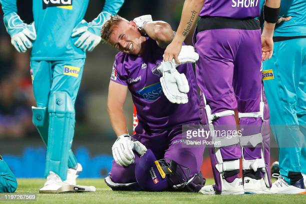 Ben McDermott of the Hurricanes reacts after hurting himself whilst diving to return to the crease during the Big Bash League match between the...