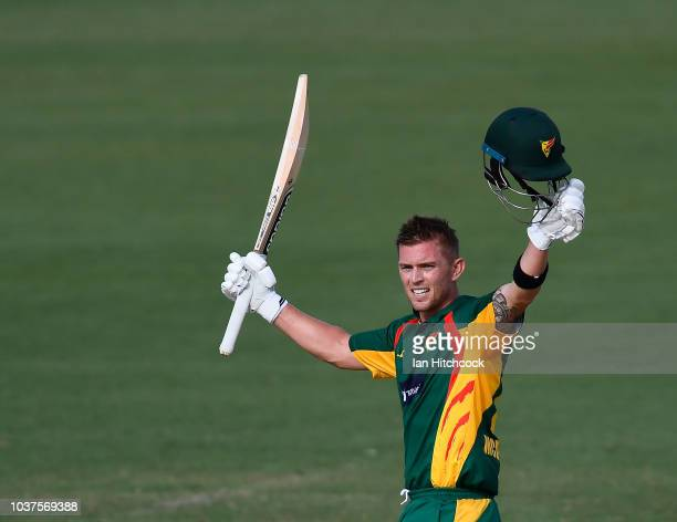 Ben McDermott of the Tigers celebrates after scoring a century during the JLT One Day Cup match between Queensland and Tasmania at Riverway Stadium...