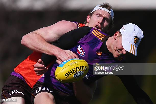 Ben McEvoy of the Hawks ackles Will Langford during a Hawthorn Hawks AFL training session at Waverley Park on September 6 2016 in Melbourne Australia