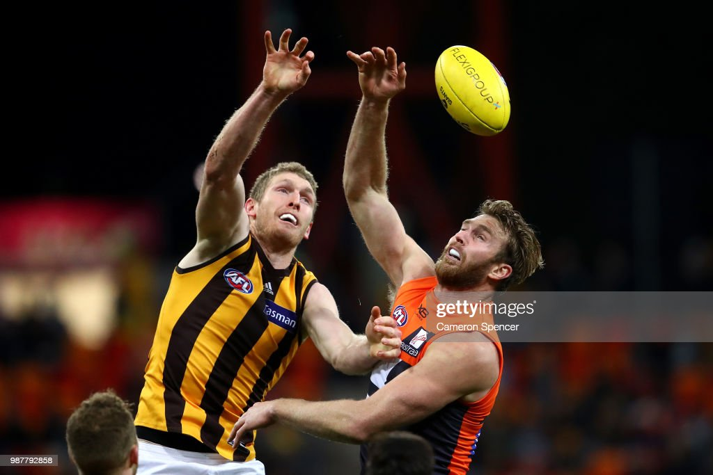 Ben McEvoy of the Hawks and Dawson Simpson of the Giants contest the ball during the round 15 AFL match between the Greater Western Sydney Giants and the Hawthorn Hawks at Spotless Stadium on June 30, 2018 in Sydney, Australia.