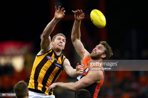 Ben McEvoy of the Hawks and Dawson Simpson of the Giants contest the ball during the round 15 AFL match between the Greater Western Sydney Giants and...