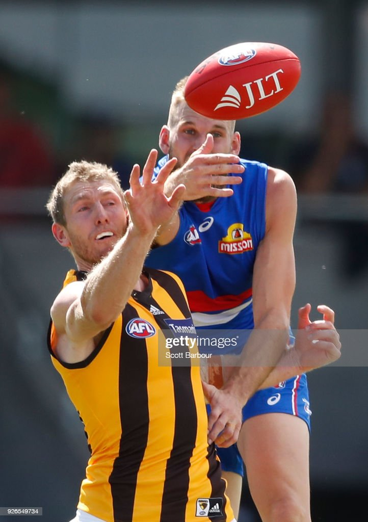 Ben McEvoy of the Hawks and Jackson Trengove of the Bulldogs compete for the ball during the AFL JLT Community Series match between the Western Bulldogs and the Hawthorn Hawks at Mars Stadium on March 3, 2018 in Ballarat, Australia.