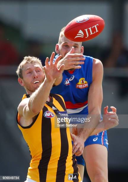 Ben McEvoy of the Hawks and Jackson Trengove of the Bulldogs compete for the ball during the AFL JLT Community Series match between the Western...