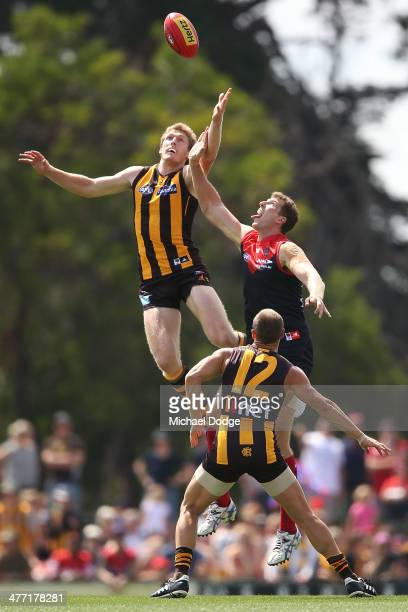 Ben McEvoy of the Hawks and Jake Spencer of the Demons contest for the ball during the AFL practice match between the Melbourne Demons and the...