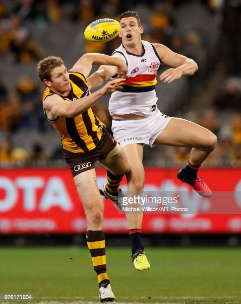 Ben McEvoy of the Hawks and Josh Jenkins of the Crows compete in a ruck contest during the 2018 AFL round 13 match between the Hawthorn Hawks and the...