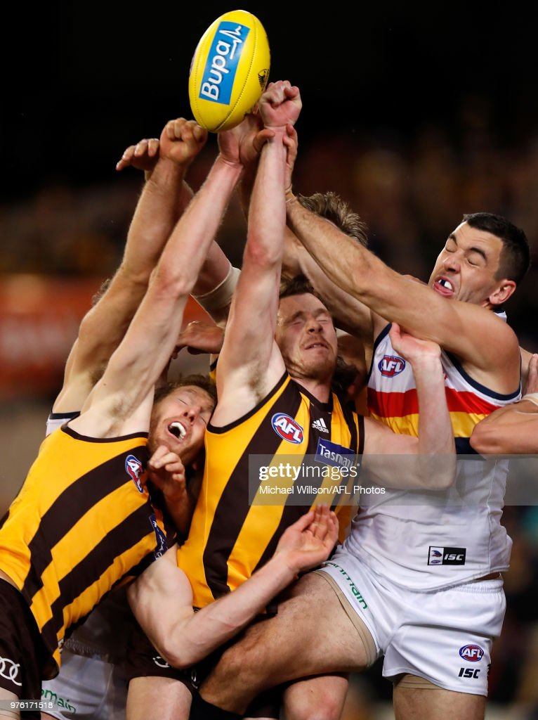 Ben McEvoy of the Hawks, Blake Hardwick of the Hawks and Taylor Walker of the Crows compete for the ball during the 2018 AFL round 13 match between the Hawthorn Hawks and the Adelaide Crows at the Melbourne Cricket Ground on June 16, 2018 in Melbourne, Australia.