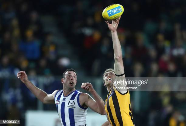 Ben McEvoy of the Hawks challenges Todd Goldstein of the Kangaroos during the round 21 AFL match between the Hawthorn Hawks and the North Melbourne...