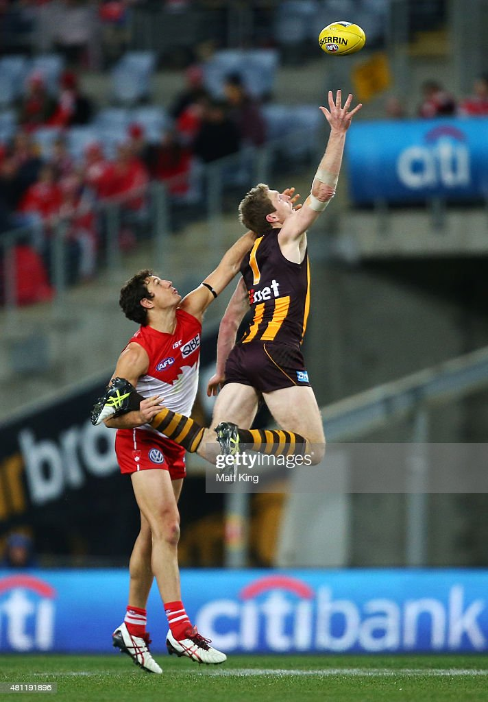 Ben McEvoy of the Hawks is challenged by Kurt Tippett of the Swans during the round 16 AFL match between the Sydney Swans and the Hawthorn Hawks at ANZ Stadium on July 18, 2015 in Sydney, Australia.