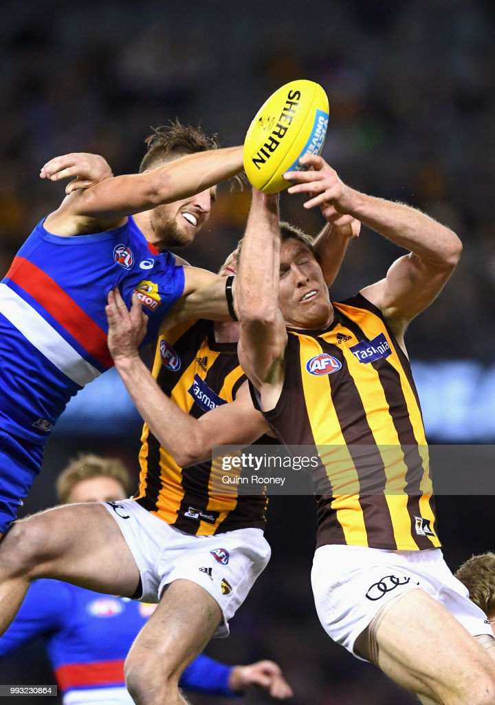 Ben McEvoy of the Hawks marks infront of Marcus Bontempelli of the Bulldogs during the round 16 AFL match between the Western Bulldogs and the Hawthorn Hawks at Etihad Stadium on July 7, 2018 in Melbourne, Australia.